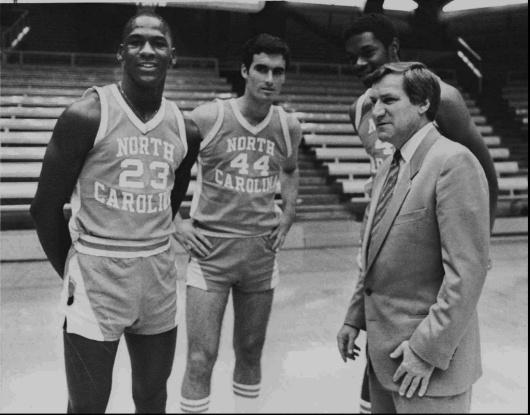 north carolina coach dean smith talks to michael jordan